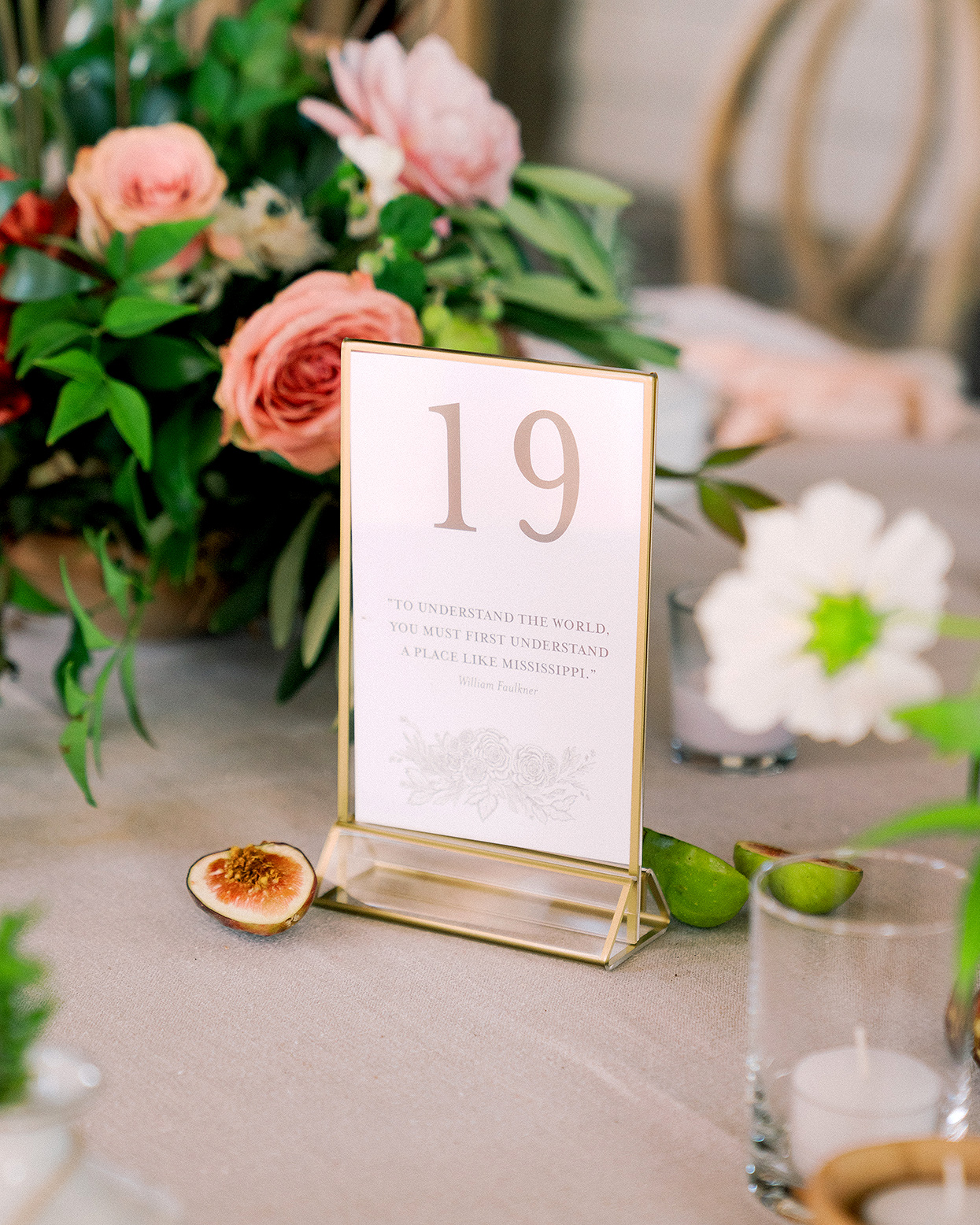 Claire and Dan's reception table number in gold frame