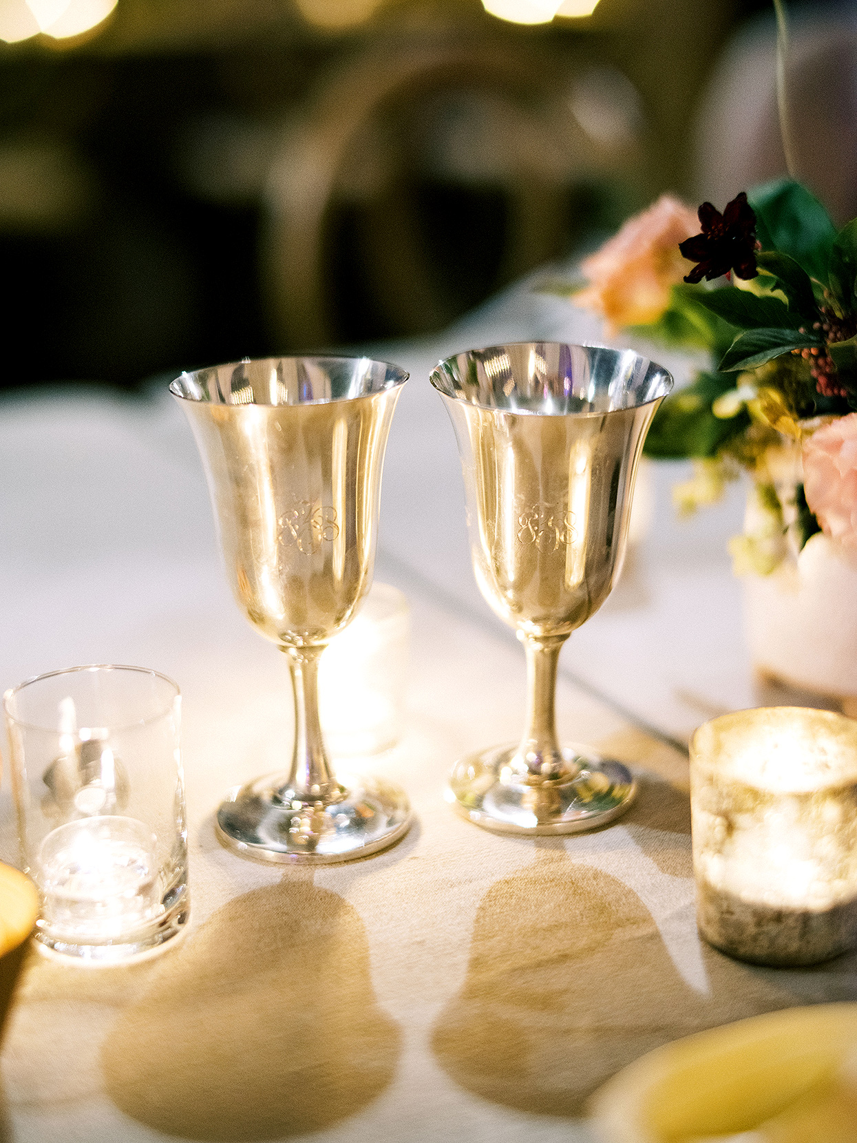 Claire and Dan's engraved sterling toasting flutes on reception table