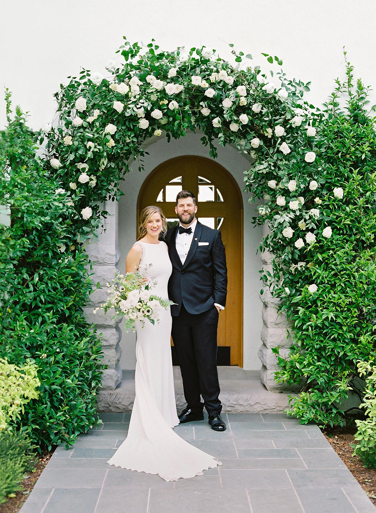 hillary alexander wedding couple under arch