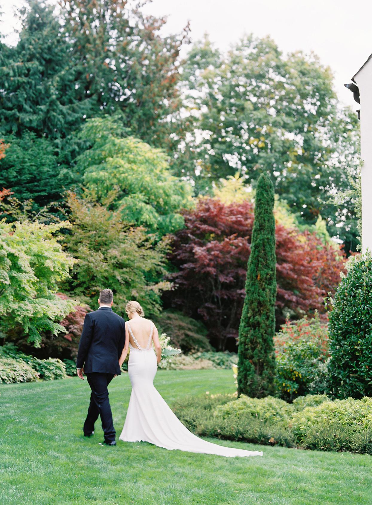 hillary alexander wedding couple walking through garden