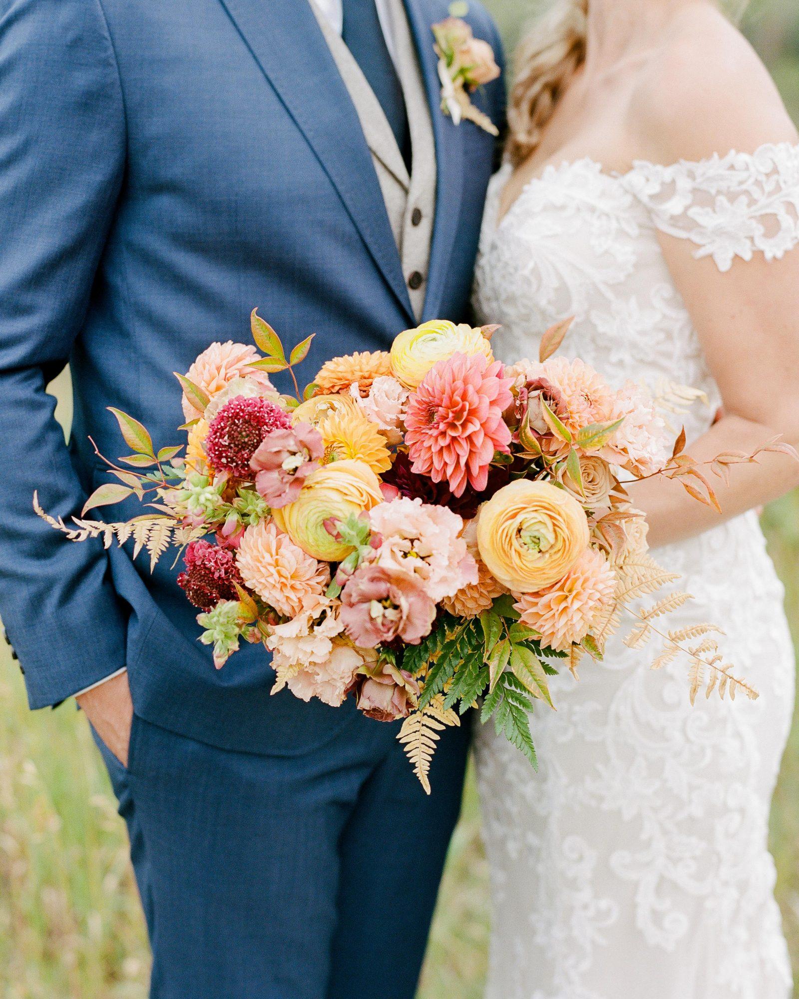 jill phil wedding couple bride's floral bouquet
