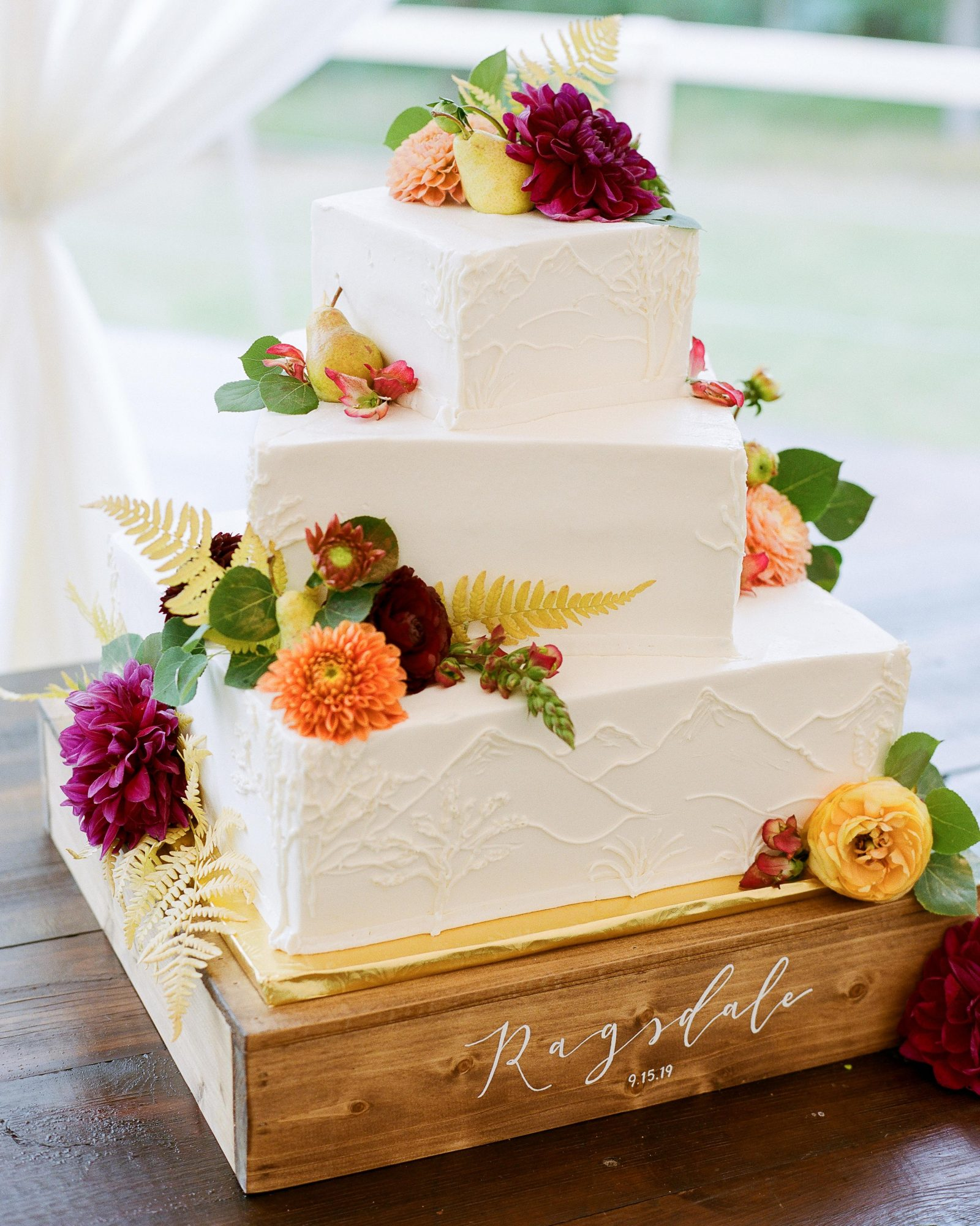 jill phil wedding three-tiered cake with flower accents