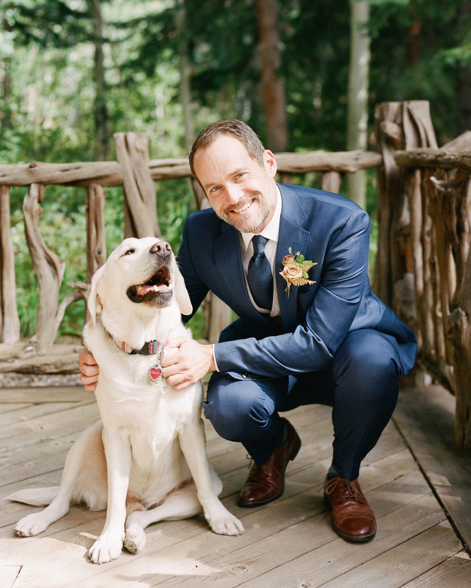 jill phil wedding groom posing with dog
