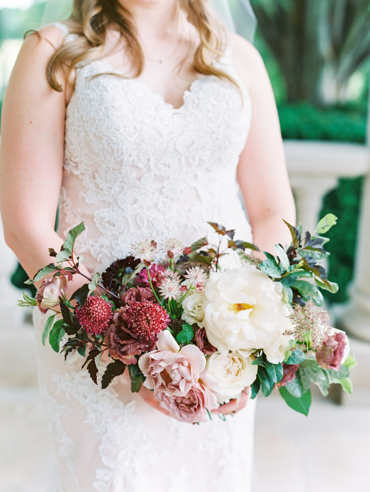 katelyn jose wedding bride in dress holding floral bouquet