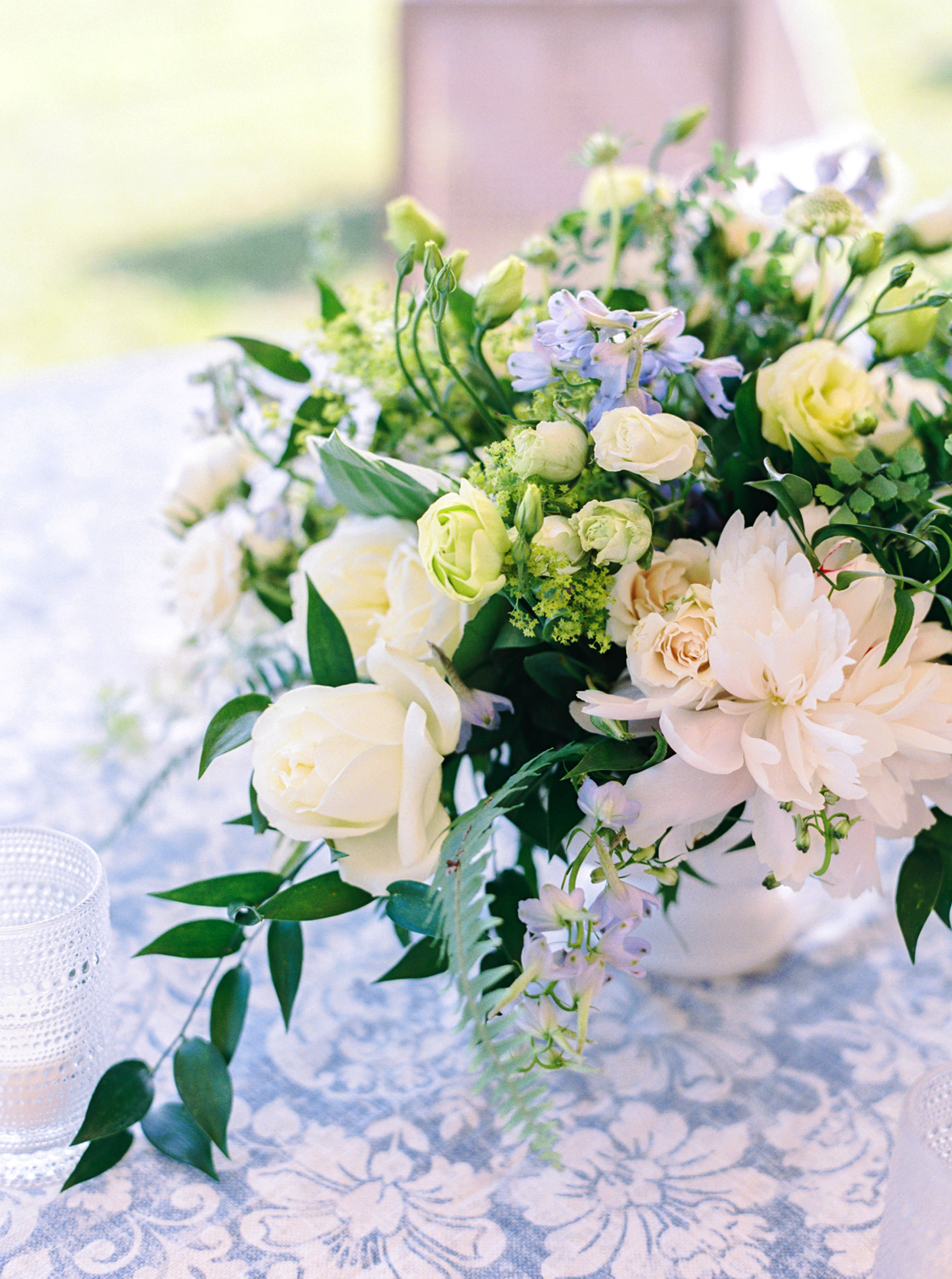 floral and greenery filled low vase table centerpieces
