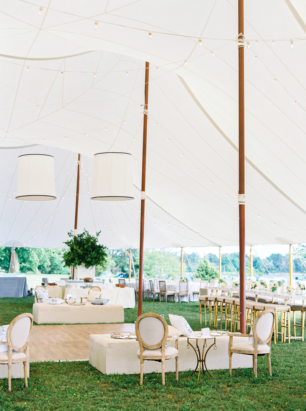 reception dance floor under large white tent