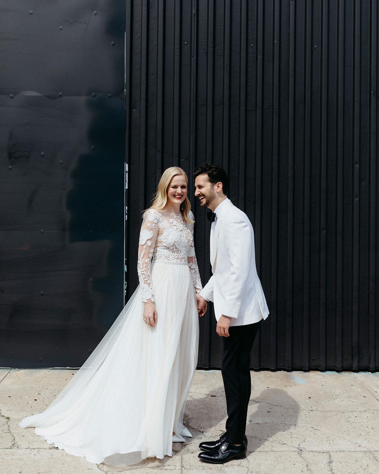 kristen jonathan wedding couple black wall