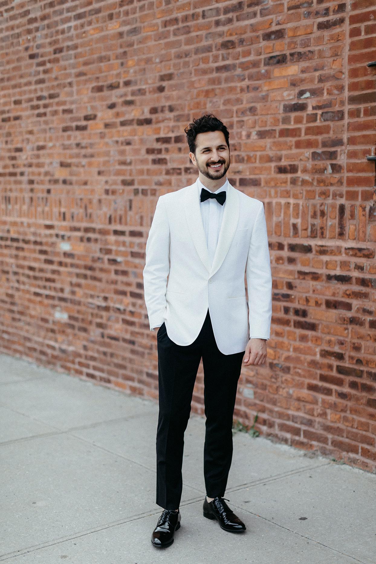 kristen jonathan wedding groom brick wall