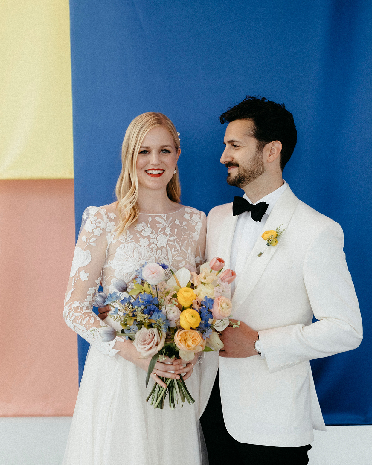 kristen jonathan wedding portraits in front of colorful installation