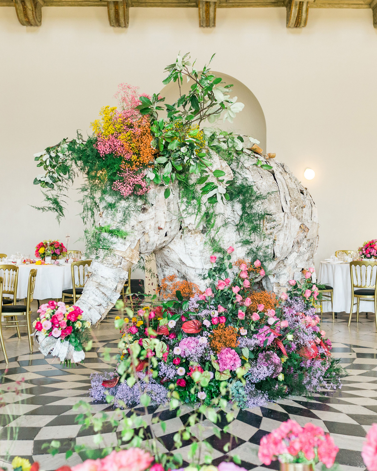 life sized asian elephant centerpiece decorated with floral display