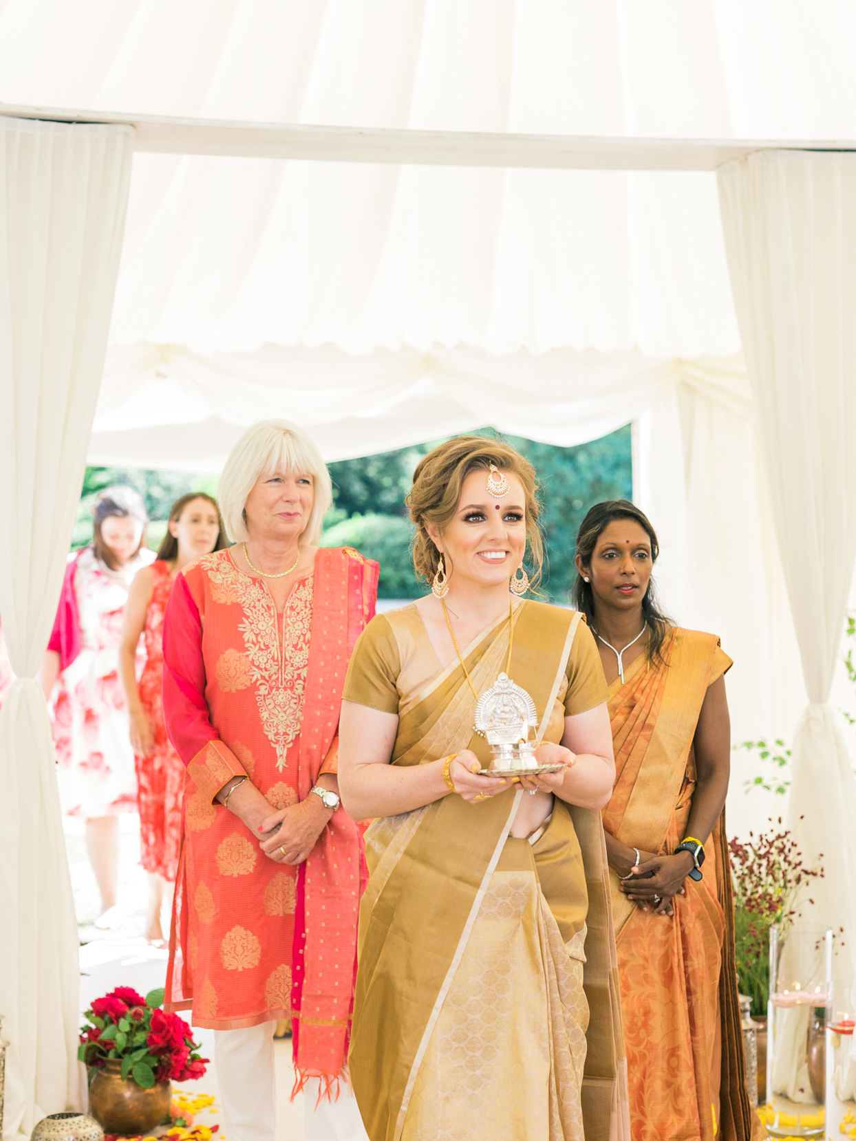 bride wedding ceremony entrance with maid of honor and mother