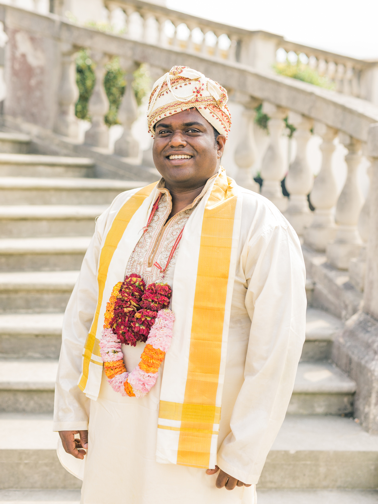 groom wearing traditional Tamil outfit with a dhoti and silk top