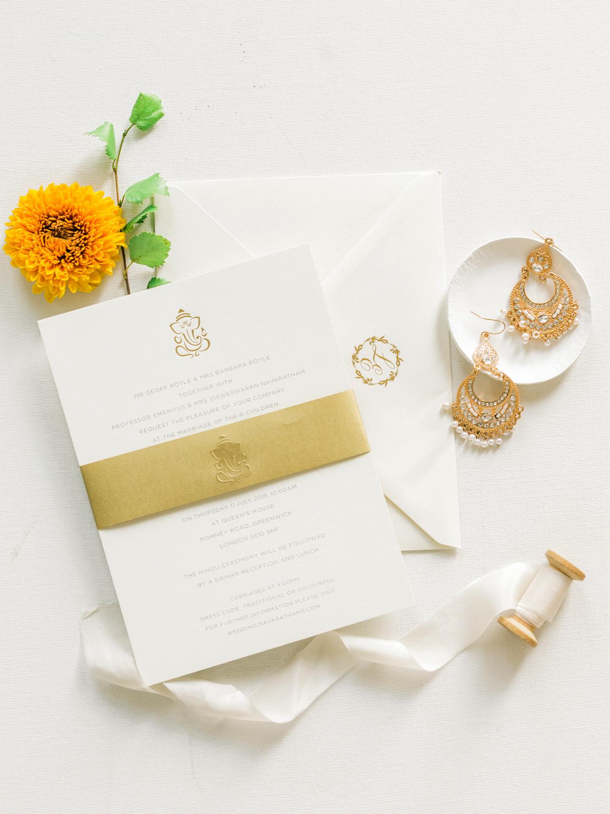 white stationery, grey font, gold accents, Ganesh illustration wedding invites