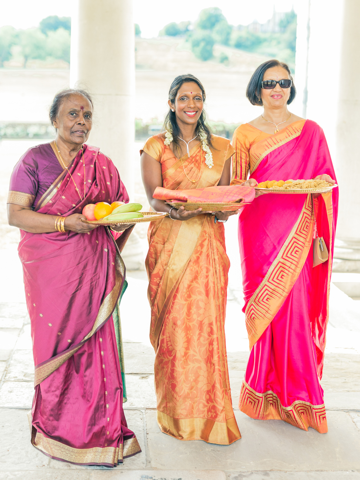 maid of honor and family wearing colorful saris