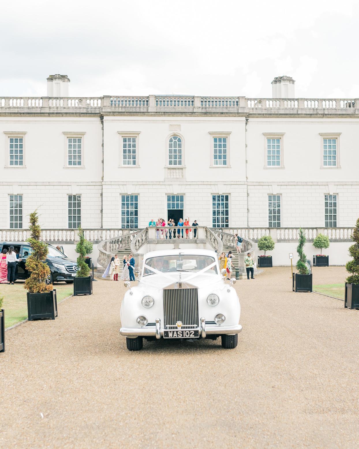 white vintage Rolls Royce sendoff vehicle