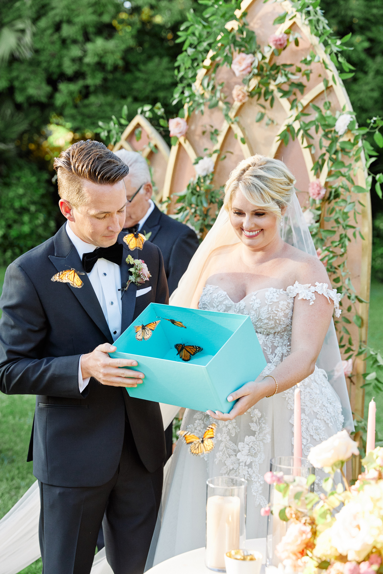 bride and groom releasing butterflies from blue box