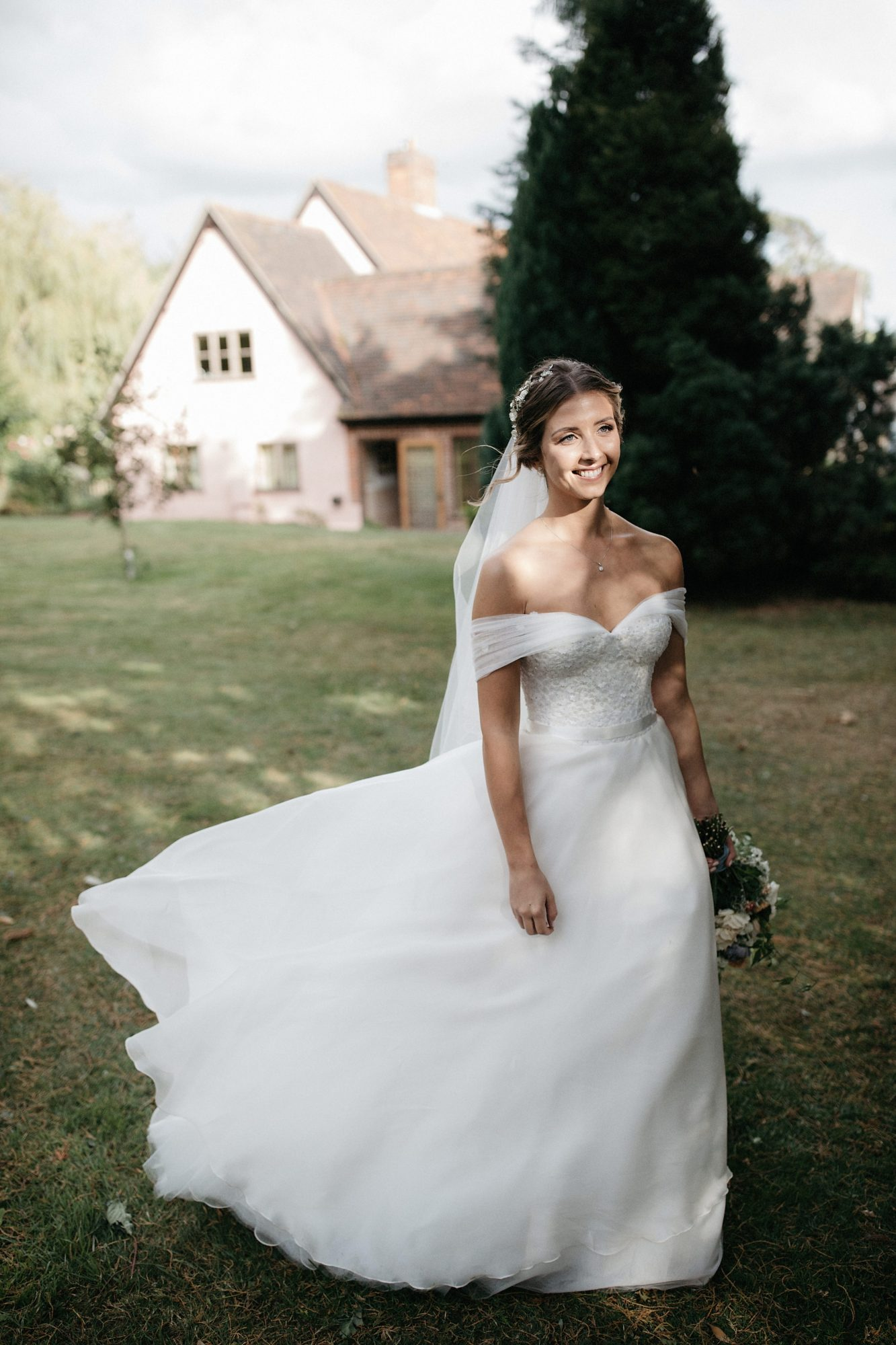 laurie lee wedding bride in dress and holding bouquet