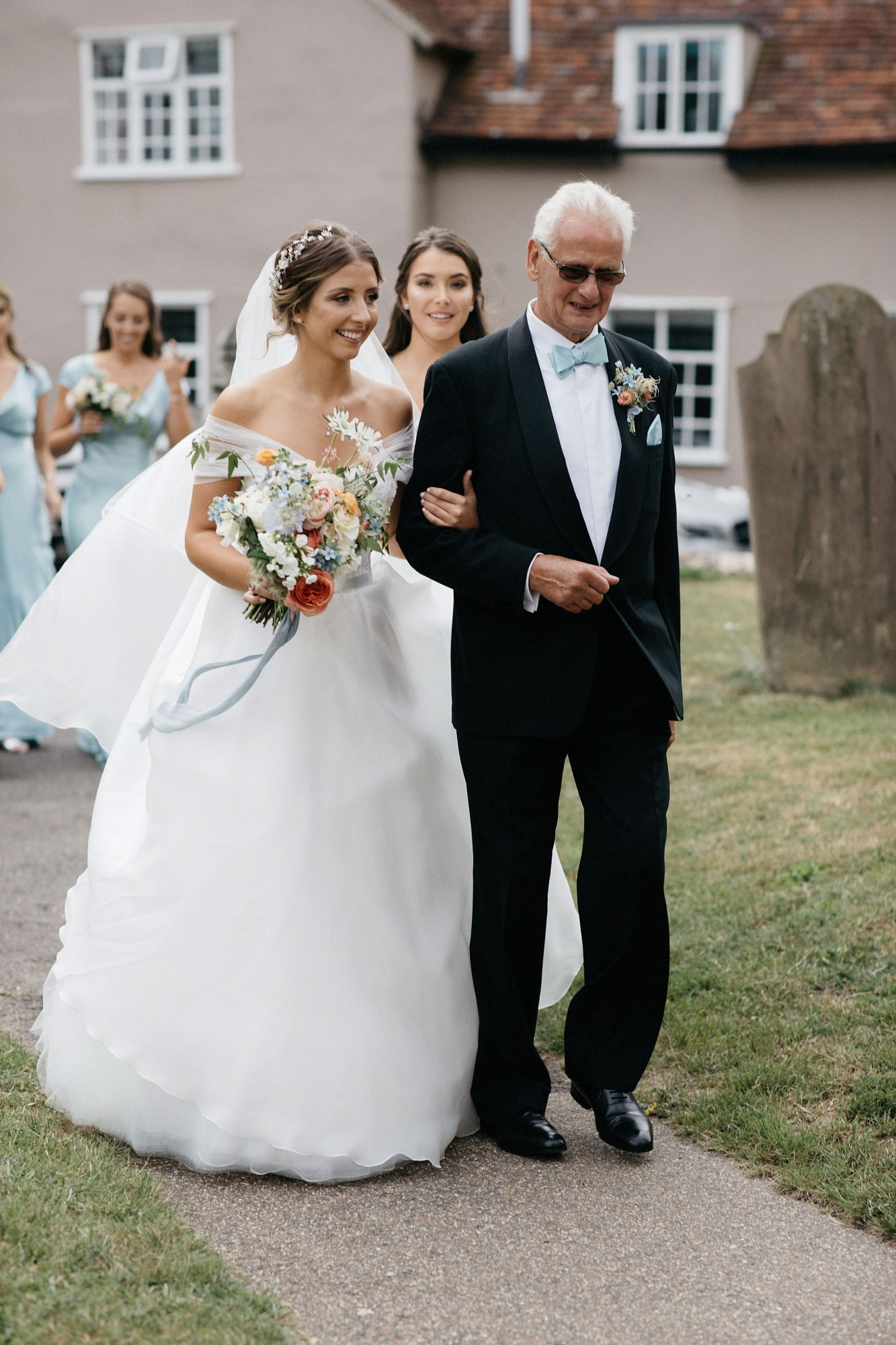 laurie lee wedding bride walking down the aisle with father