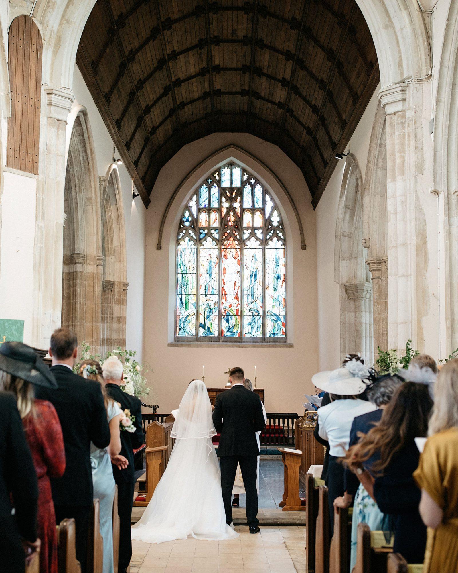 laurie lee wedding couple ceremony venue interior