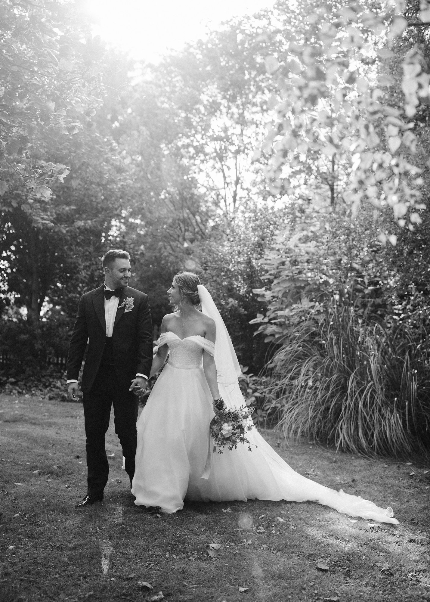 laurie lee wedding couple pose in wooded area