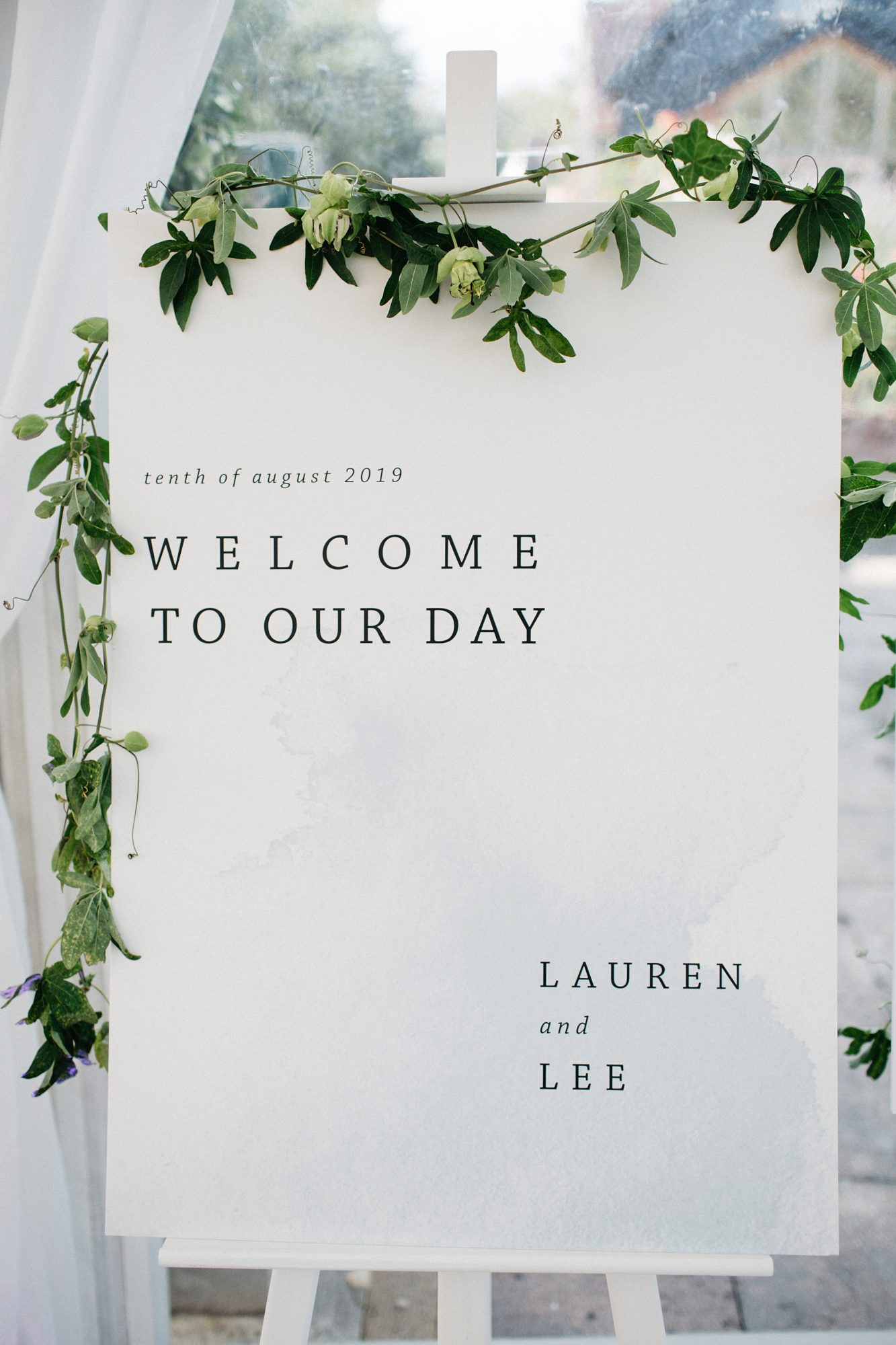 laurie lee wedding welcome sign with green floral decor