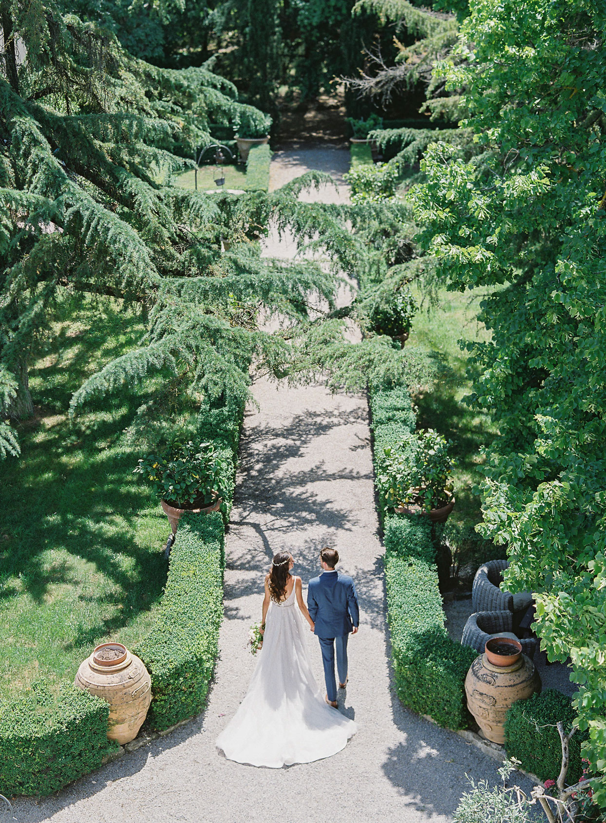 aeiral view of wedding couple outdoor garden pathway