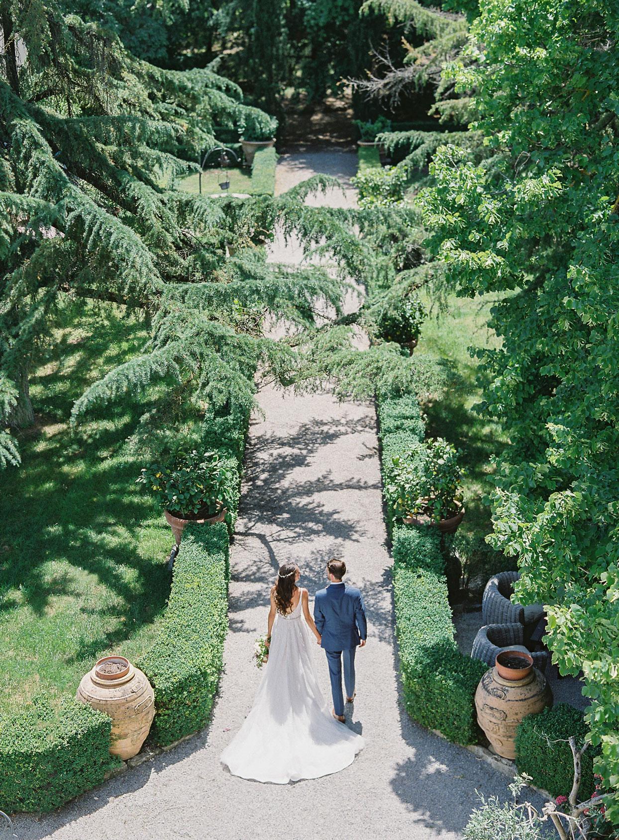 aeiral view of wedding couple outdoor garden pathway