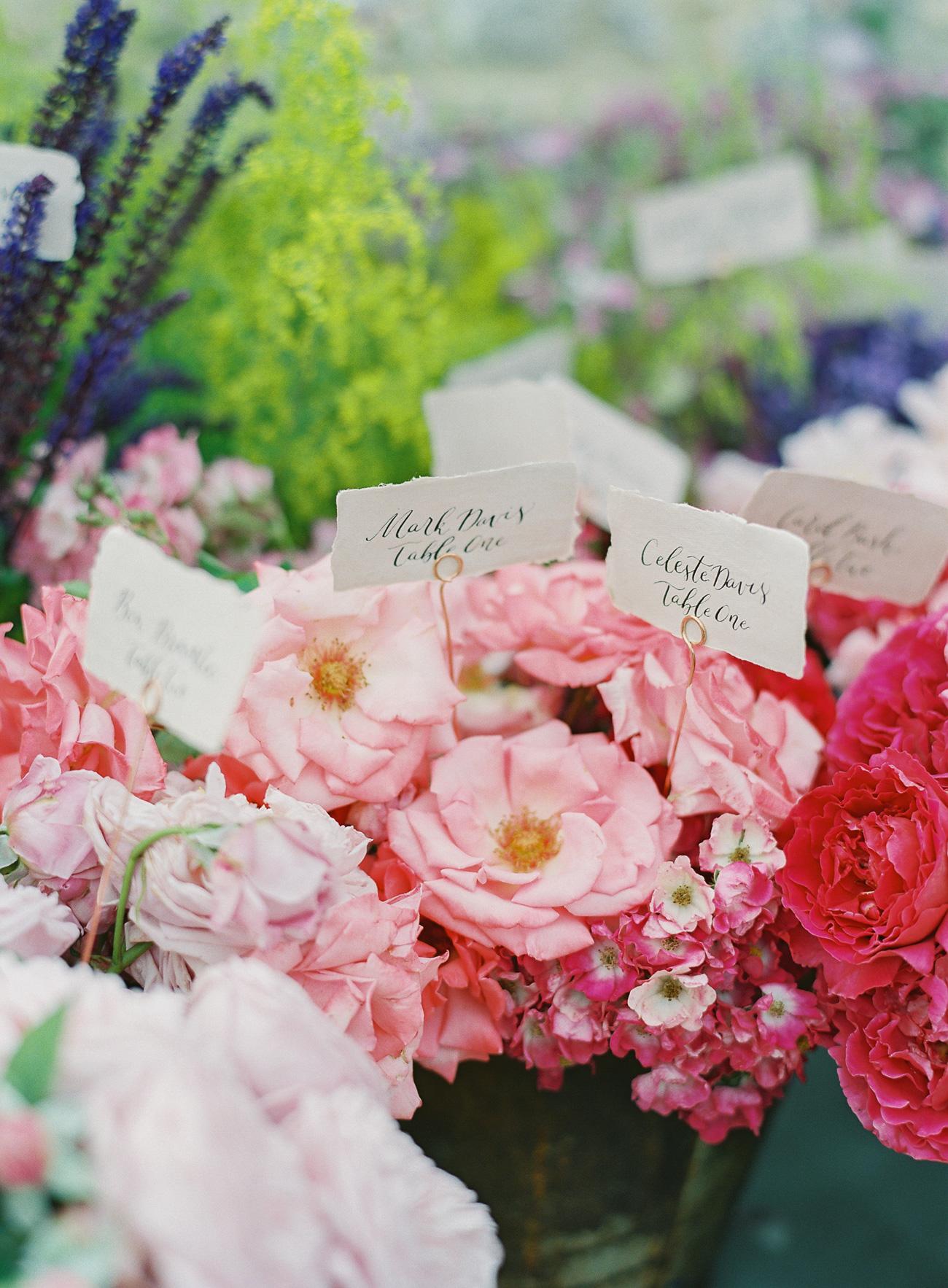 escort cards among floral arrangements
