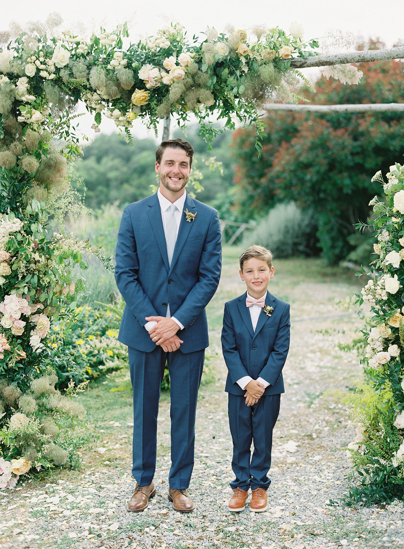 outdoor portrait groom and ring bearer