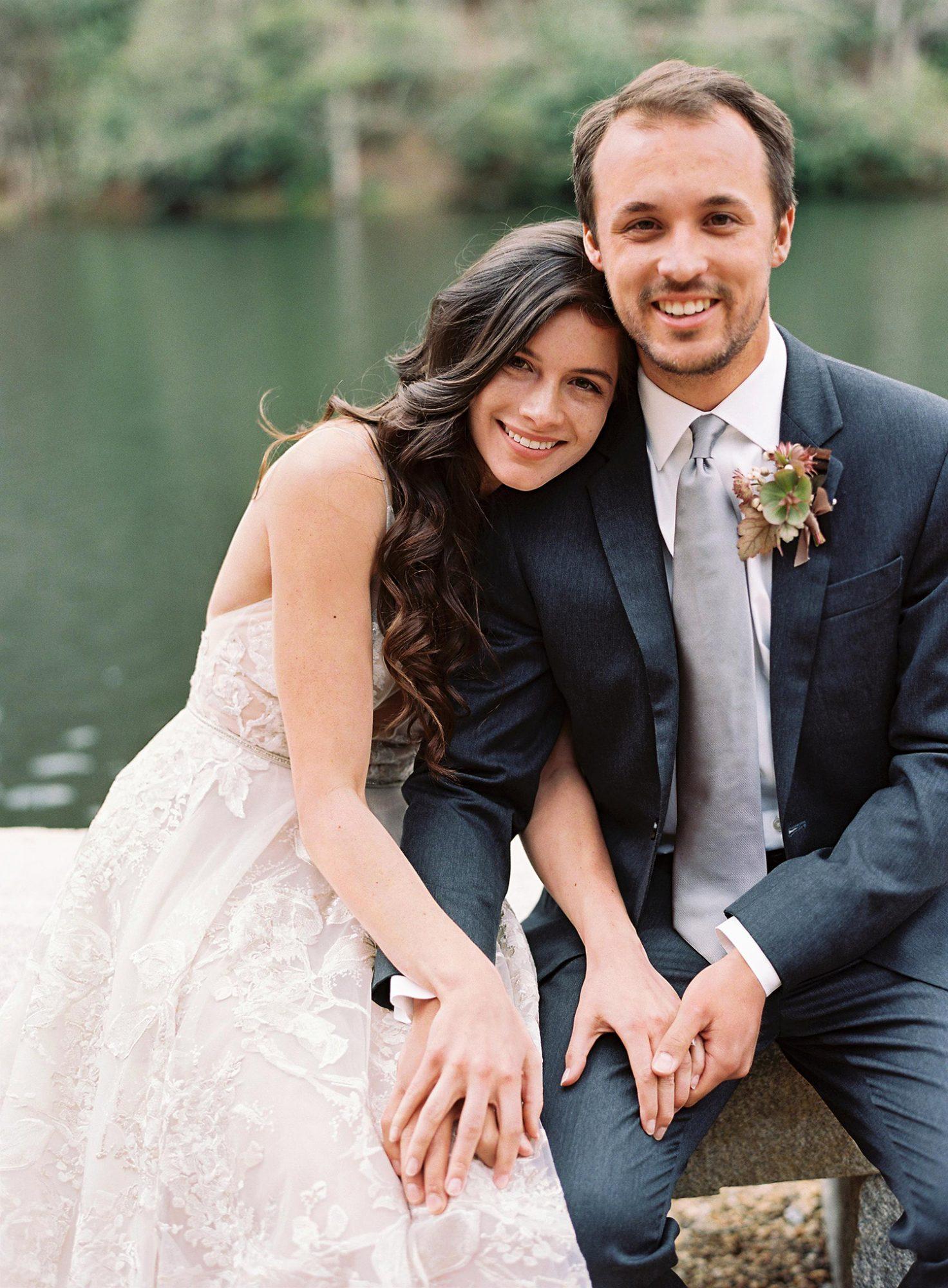 maya trey wedding couple seated holding hands