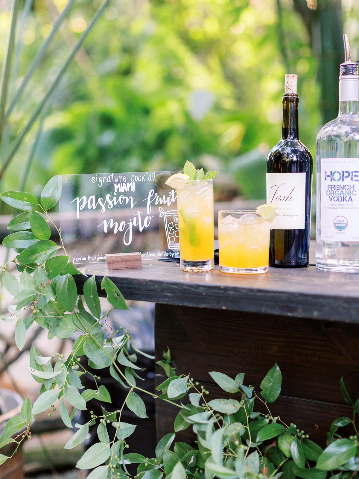 melissa lindsey wedding cocktail drink station greenery