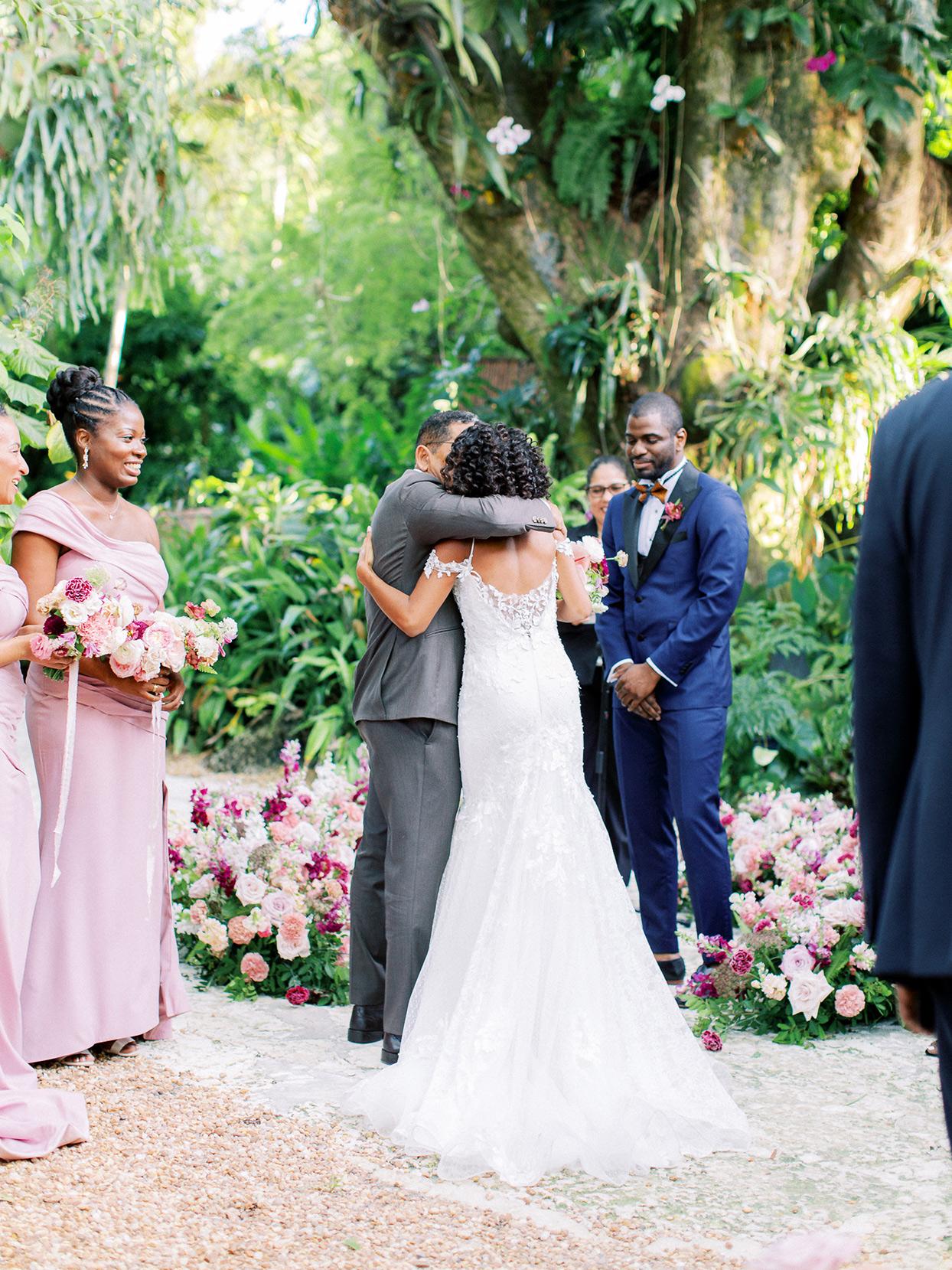 melissa lindsey wedding ceremony couple embrace