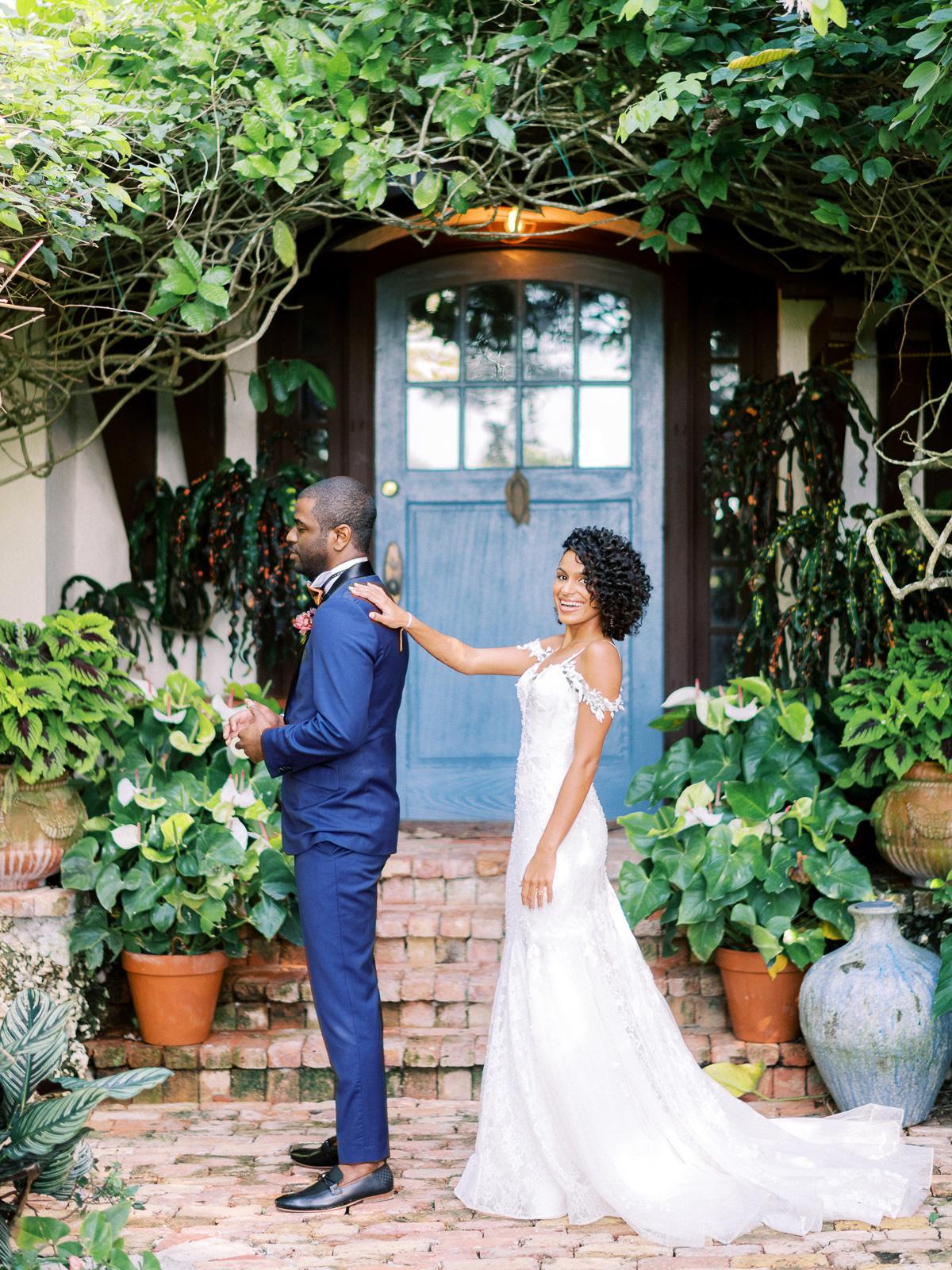 melissa lindsey wedding first look bride tapping groom shoulder