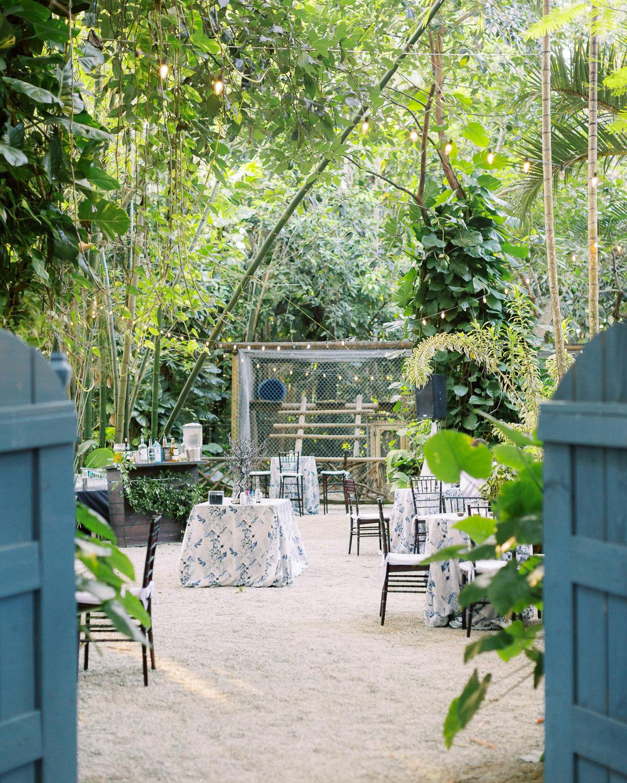 melissa lindsey wedding outdoor jungle cocktail hour blue decor