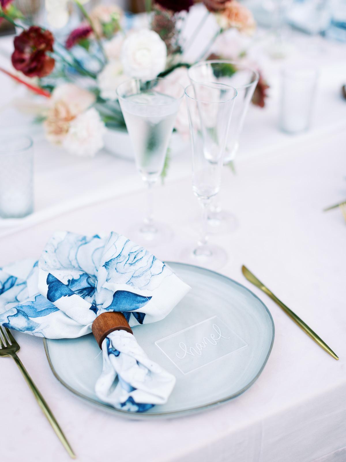 melissa lindsey wedding place setting blue and white napkin
