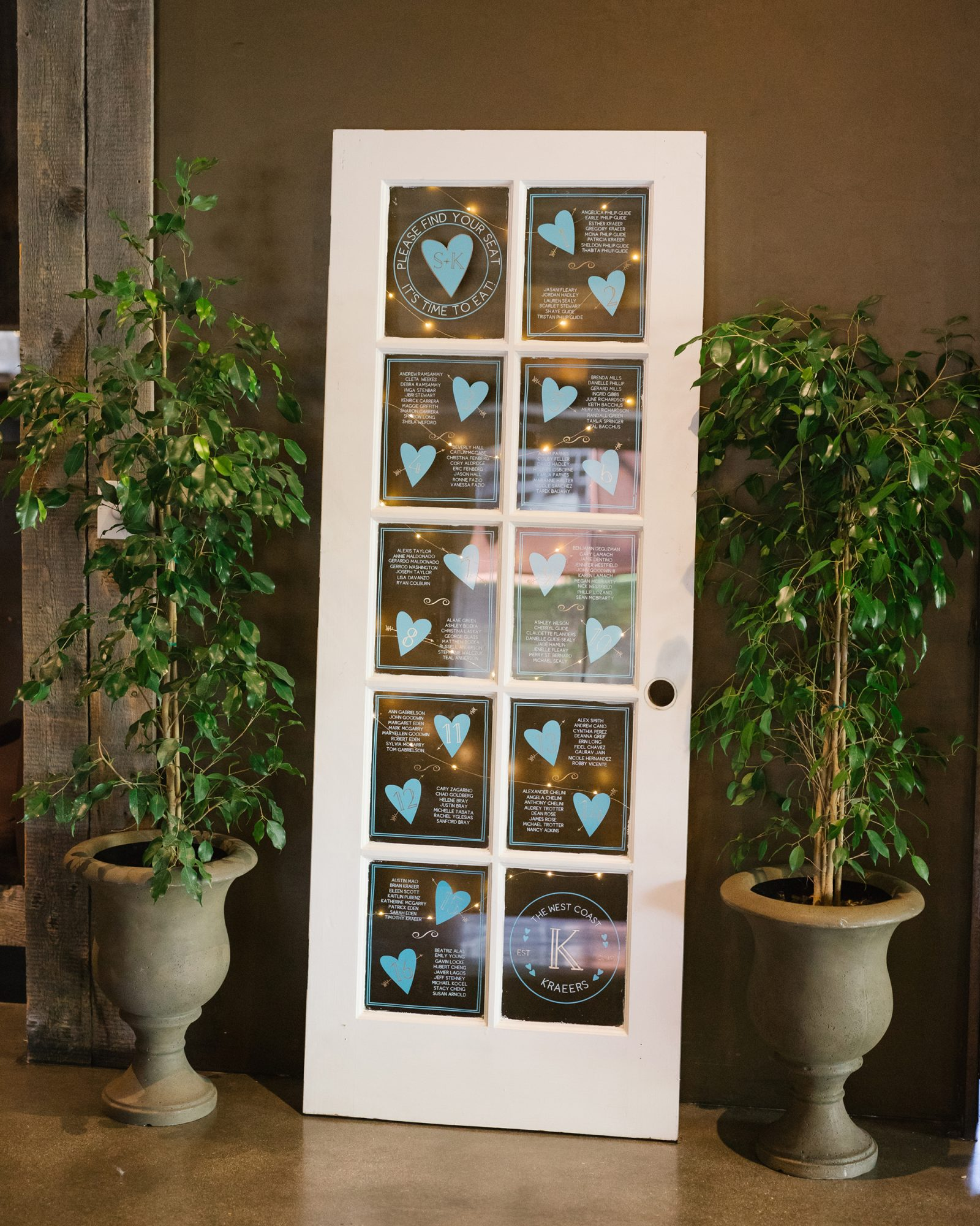 shelana kevin wedding seating chart with names written on window door design