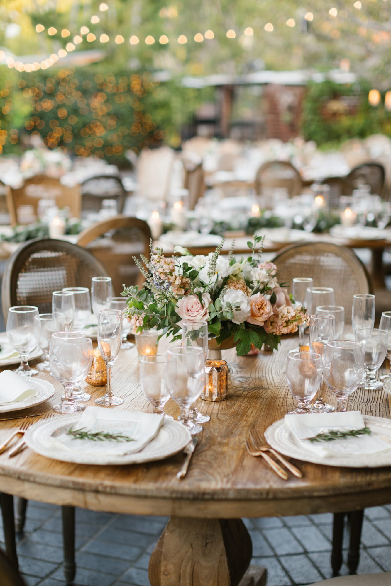 shelana kevin wedding table decor with candle and floral centerpieces