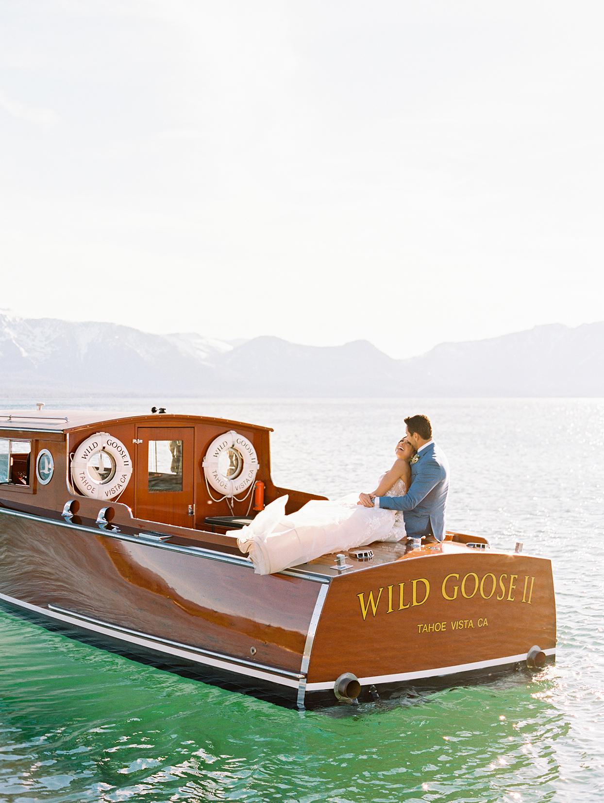 asha andrew wedding couple in boat on lake tahoe