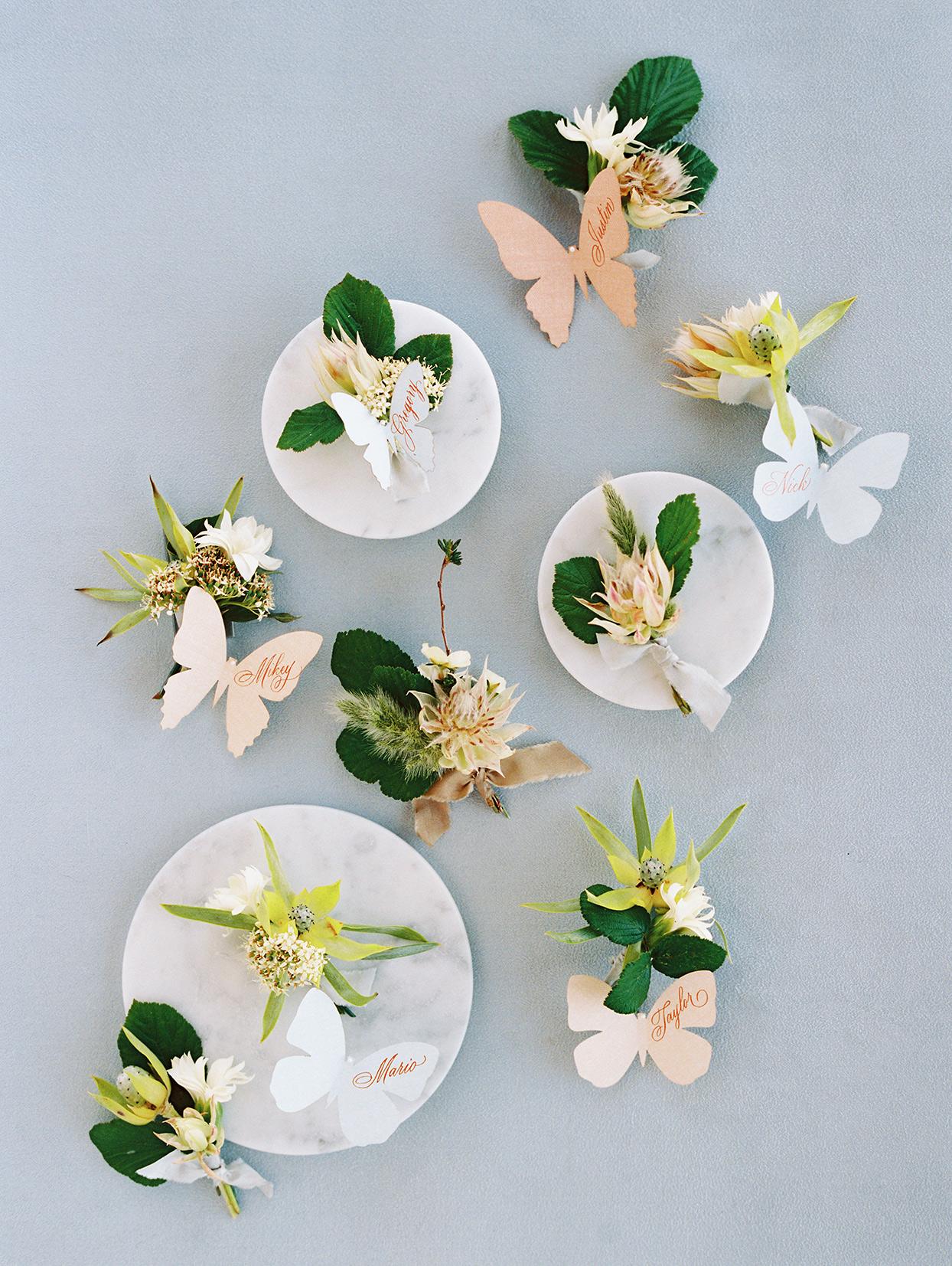 asha andrew wedding boutonnieres on plates