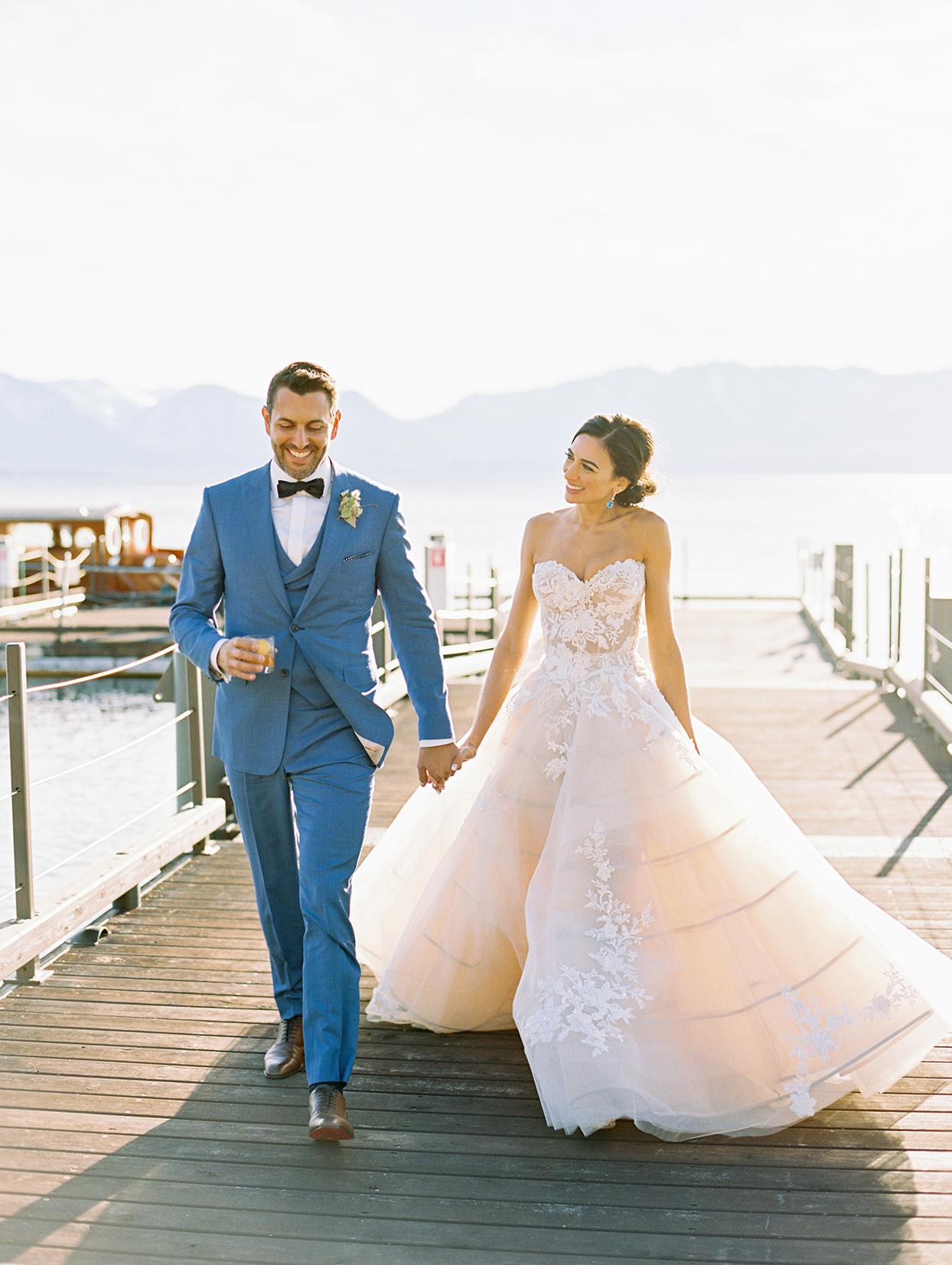 asha andrew wedding couple walking on dock