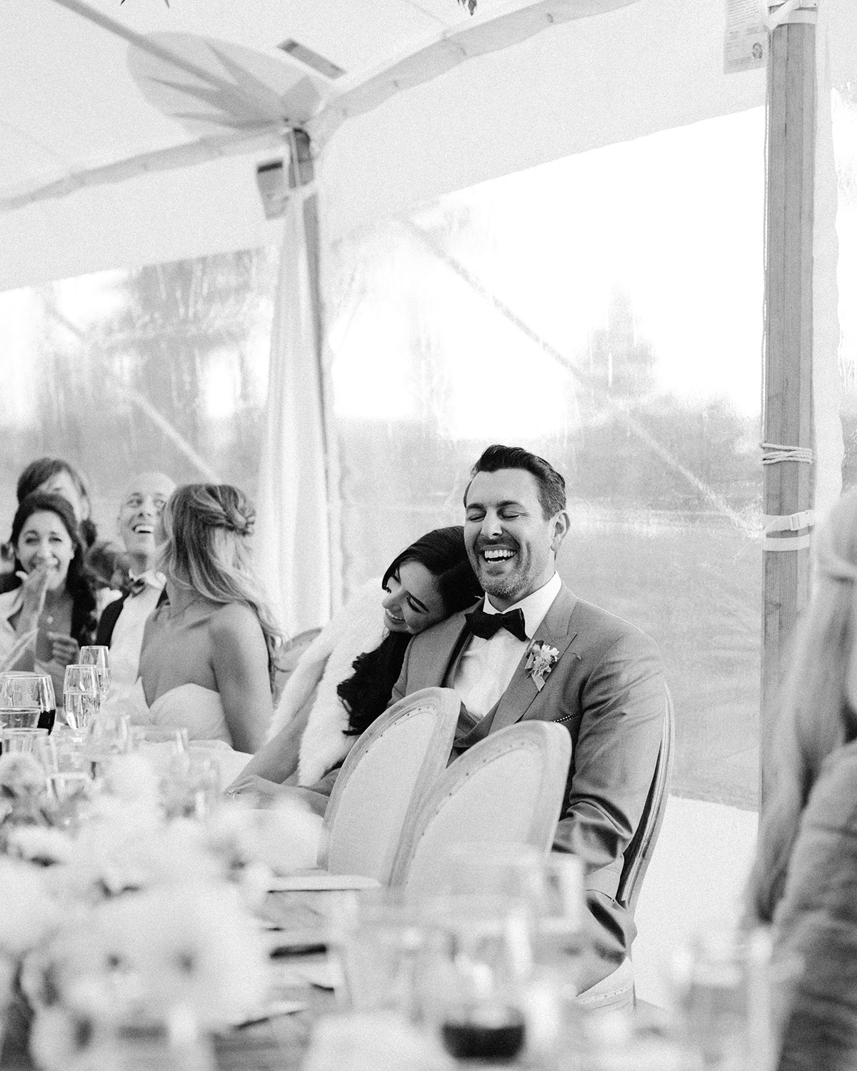 asha andrew wedding couple laughing at reception