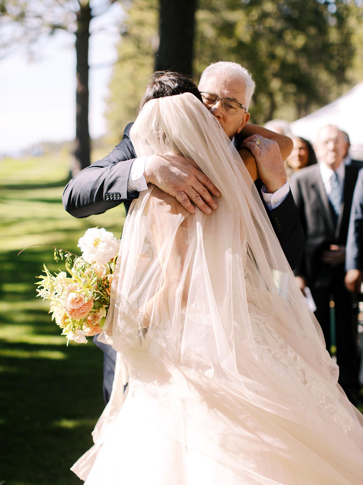 asha andrew wedding bride hugging father