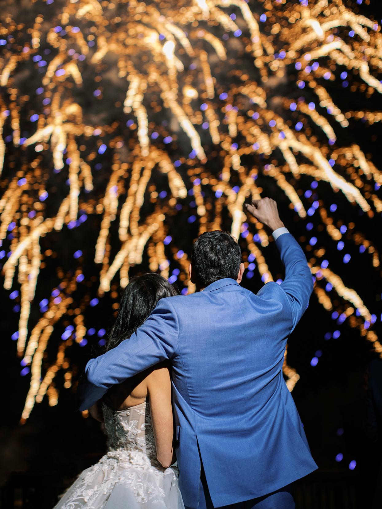 asha andrew wedding couple watching fireworks
