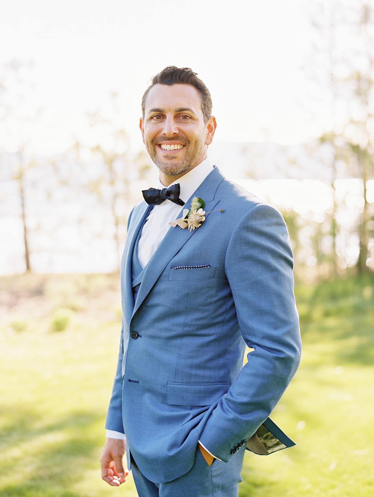 asha andrew wedding groom in blue