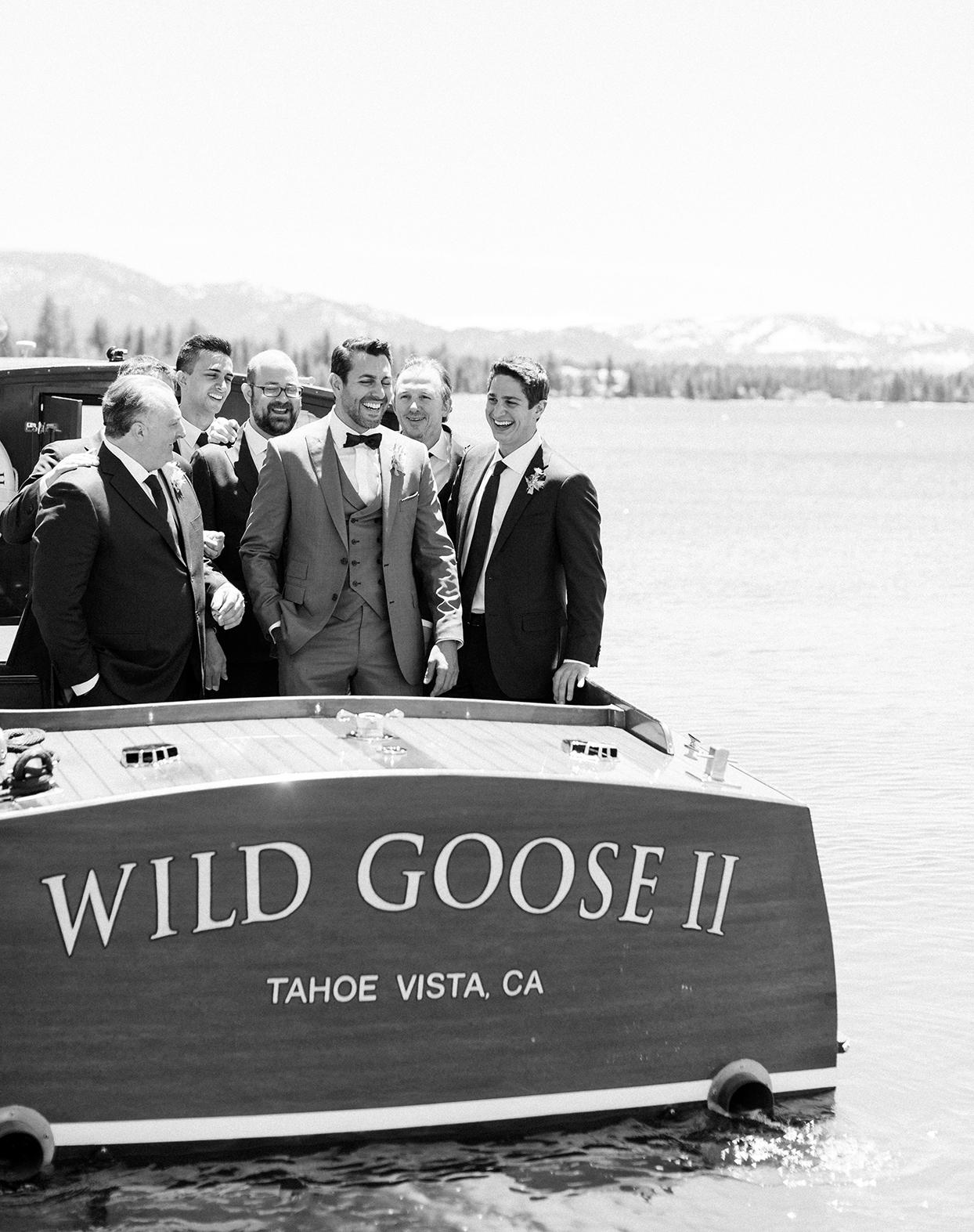 asha andrew wedding groomsmen on boat