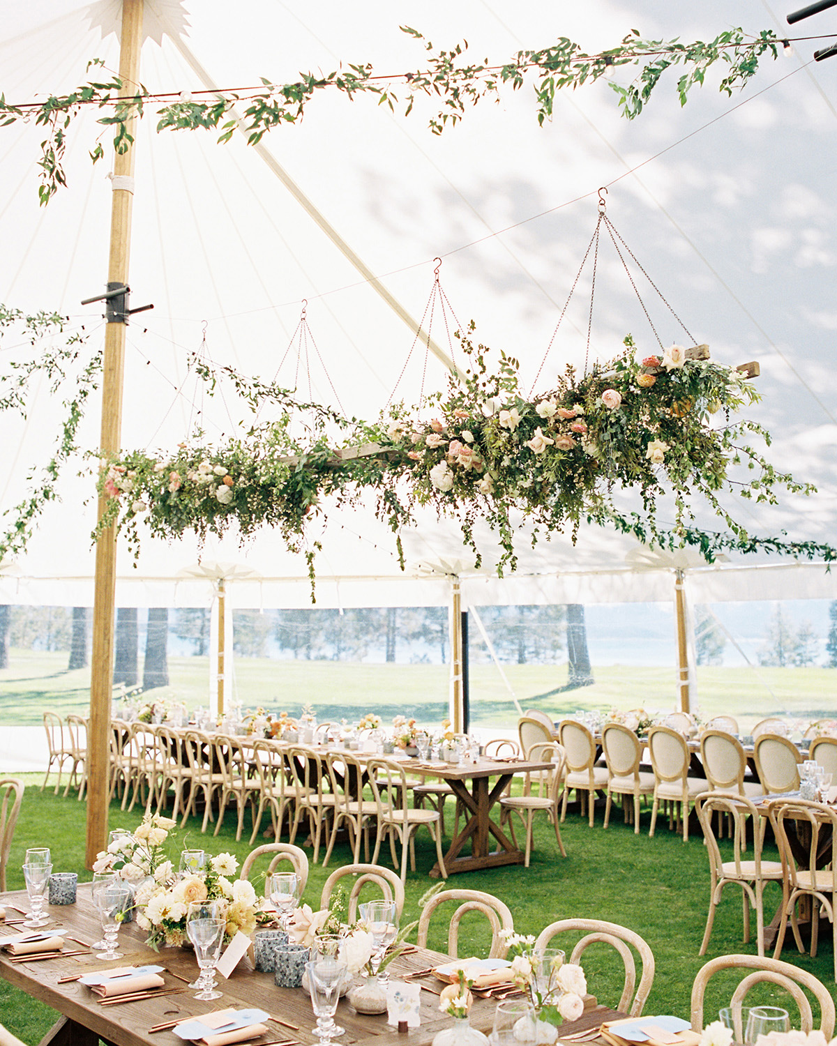 asha andrew wedding reception tent with hanging flowers