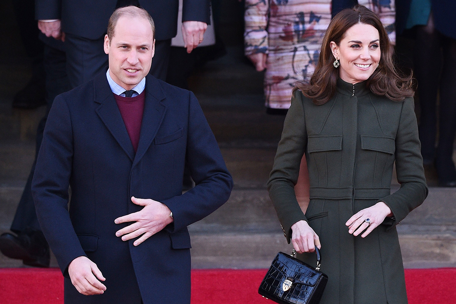 Britain's Prince William, Duke of Cambridge, (L) and Britain's Catherine, Duchess of Cambridge (R) leave after visiting City Hall in Centenary Square, Bradford on January 15, 2020, to meet young people and hear about their life in Bradford