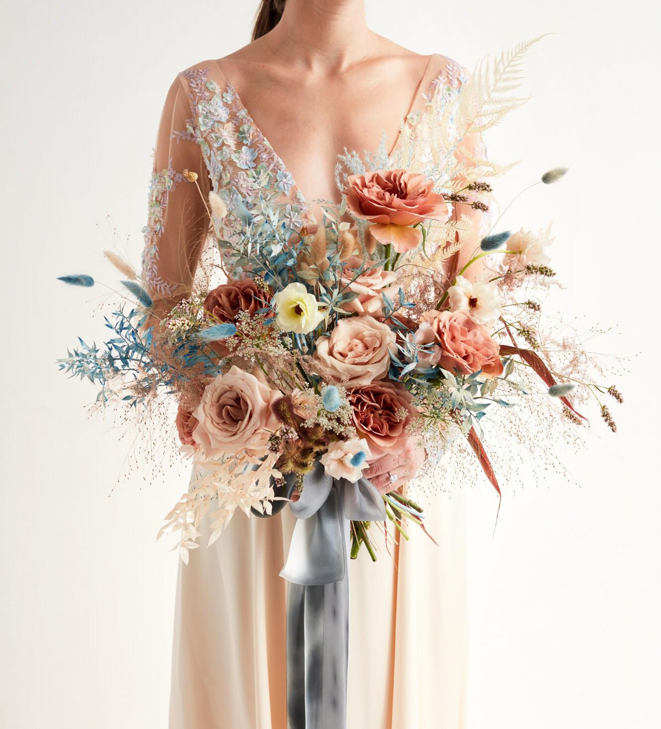 Bride Holding Colorful Bouquet with Dried Flowers
