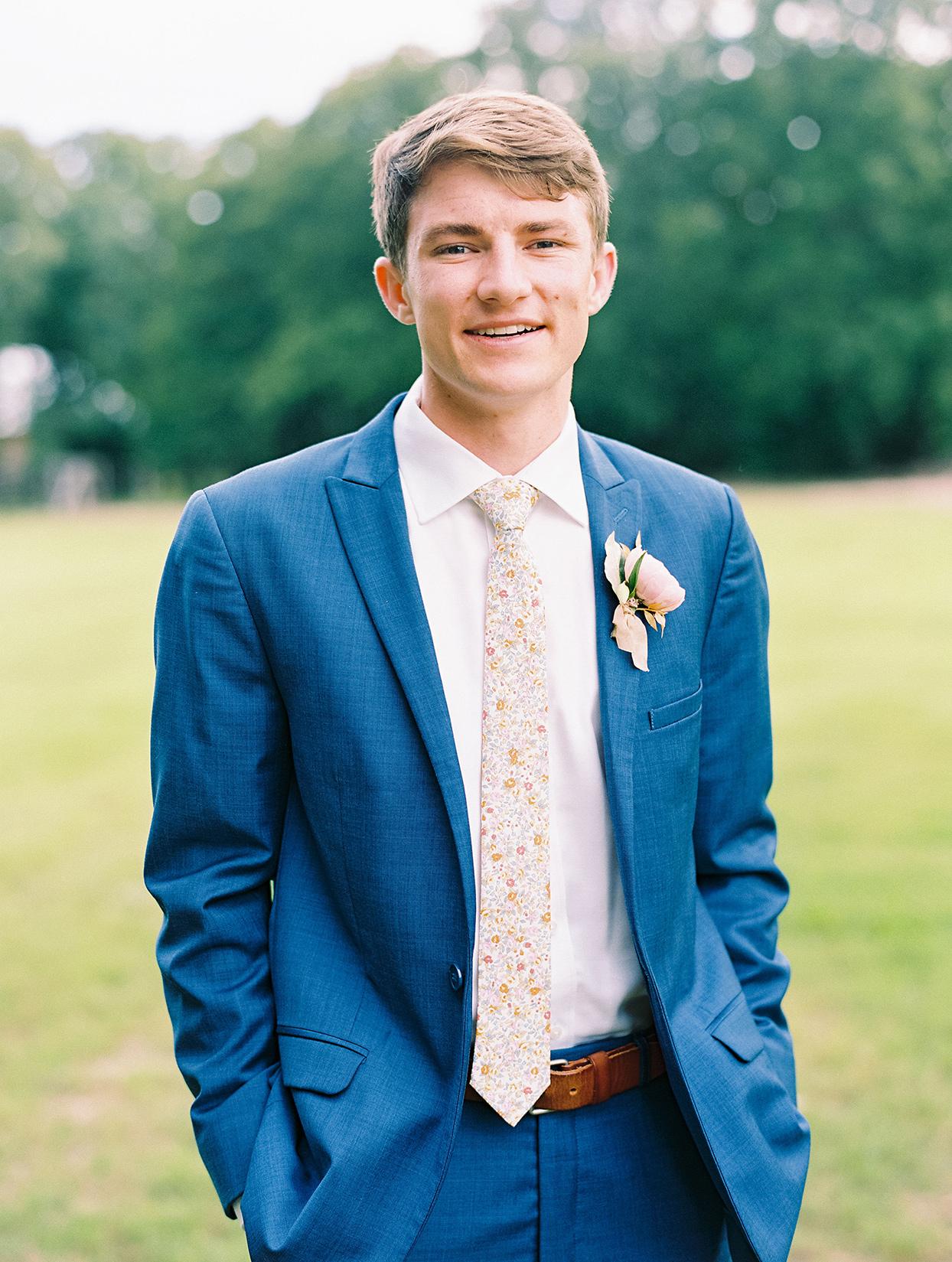 evie joe wedding groom in blue suit with flowered tie