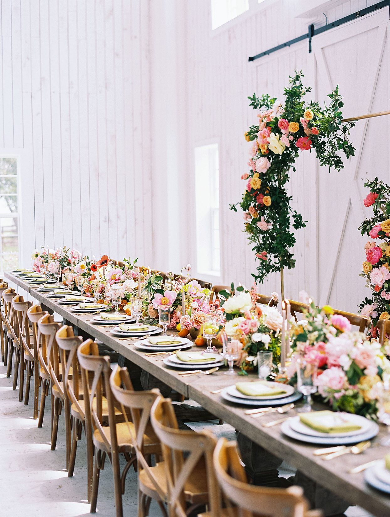 evie joe wedding reception long table with floral centerpieces